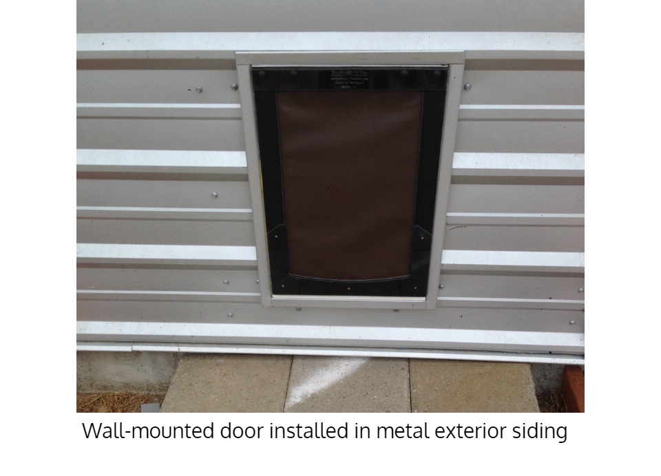 Freedom Pet Pass dog door for walls installed in metal siding