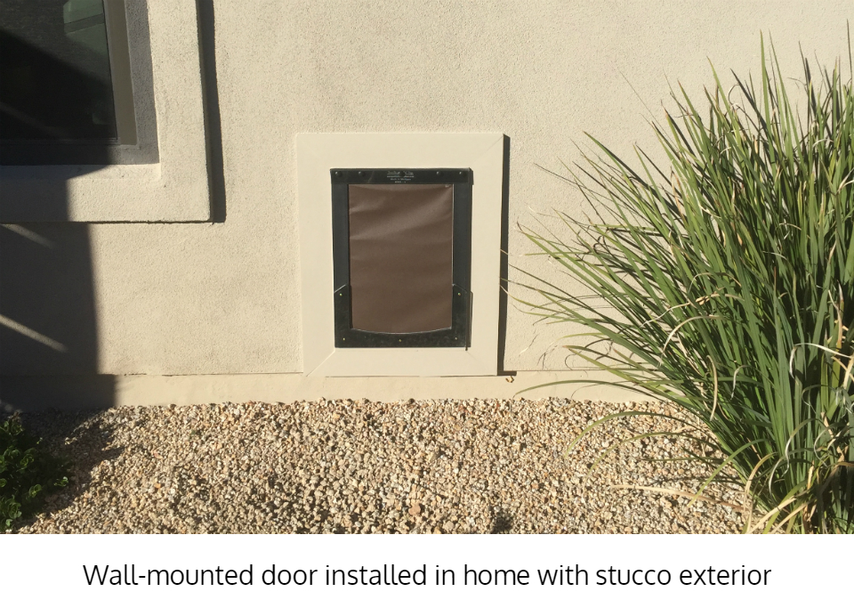 Freedom Pet Pass dog door in stucco wall